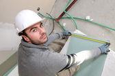 Man measuring plaster-board — Stock Photo