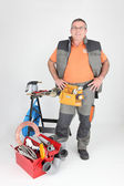 Man at workbench with tools — Stock Photo