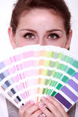 Girl hiding behind swatches — Stock Photo