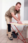 Man gluing paper together — Stock Photo