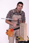 Craftsman measuring a window frame — Stock Photo