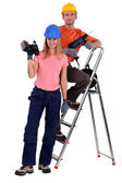 Couple of workers with power drills — Stock Photo