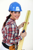 Construction worker measuring a piece of wood — Stock Photo