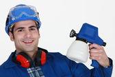 Tradesman holding a spray gun — Stock Photo