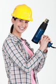 Woman holding electric heater — Stock Photo