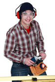 Man holding a power tool — 图库照片