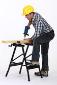Tradesman using a power tool — Stock Photo