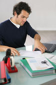 Man working at a desk — Stock Photo