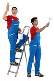 Craftsman and apprentice painting — Stock Photo