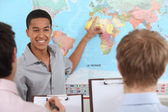 Teacher in geography class — Stock Photo