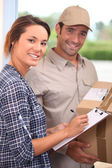 Courier with a signed-for delivery — Stock Photo