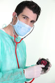 A surgeon auscultating a purse — Stock Photo