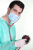 A surgeon auscultating a purse — Stock Photo