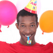 Black man at birthday's party — Stock Photo