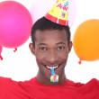 Black man at birthday's party — Stock Photo