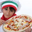 Foto Stock: Kid dressed as pizzchef
