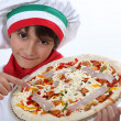 Foto de Stock  : Kid dressed as pizzchef