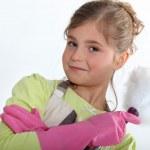 Little girl dusting — Stock Photo #8164009