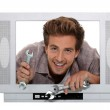 Concept shot of a television repairman — Stock Photo