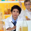 Stock Photo: Kids performing science experiment