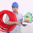 Grumpy man giving a property an energy efficiency rating of G — Stockfoto