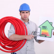 Grumpy man giving a property an energy efficiency rating of G — Stock Photo #8164248