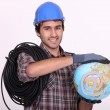 Electrician holding globe — Stock Photo #8164267