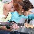Royalty-Free Stock Photo: Teenagers playing the guitar