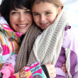 Mother and daughter in snow — Stock Photo