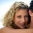 Gorgeous woman embracing her boyfriend — Stock Photo