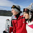 Young couple skiing - Stock Photo
