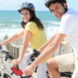 Royalty-Free Stock Photo: Young man and young woman having bike ride