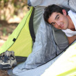 Young man camping — Stock Photo