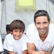Stock Photo: Father and son at camping