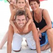 Portrait of a family on the beach — Stock Photo