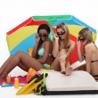 Three girls at the beach - Stock Photo