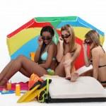 Three girls at the beach — Stock Photo