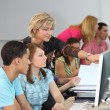 Teacher helping her students — Stock Photo