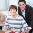 Stock Photo: Teacher helping pupil