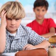 Two kids in classroom - Stock Photo