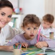 Teacher and her students — Stock Photo