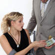 Stock Photo: Surprised woman receiving a gift from her boyfriend