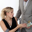 Surprised woman receiving a gift from her boyfriend — Stock Photo