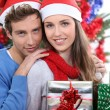Young couple at Christmas — Stock Photo #8166823