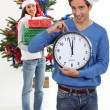 Couple eagerly waiting for Christmas Day to open presents — Stock Photo