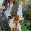 Royalty-Free Stock Photo: A hunter and his dog