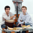 Young men at home with musical instruments — Stock Photo