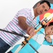 Brothers practising archery - Stock Photo