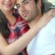 Couple sitting in the back seat of a car — Stockfoto