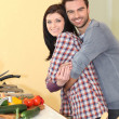 Happy couple in a kitchen — Stock Photo